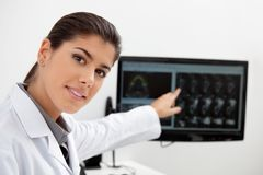 Dentist showing teeth x-ray on screen Stock Photos
