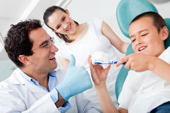Dentist showing to brush teeth Stock Images