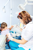 Dentist showing toy teeth Royalty Free Stock Photos