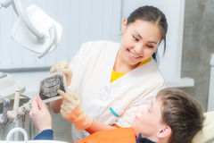 Dentist showing x-ray to a patient Royalty Free Stock Image