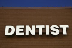 Dentist sign on the brick wall Stock Photo