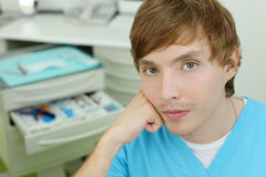 Dentist sits in cabinet of dental clinic Royalty Free Stock Photo