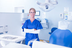 Dentist smiling at camera with arms crossed Stock Images