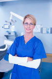 Dentist smiling at camera with arms crossed Stock Photography