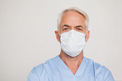 Dentist in surgical mask looking at camera Royalty Free Stock Images