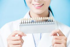 Dentist take tooth whitening tool stock images