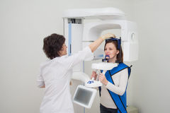 Dentist taking a panoramic digital X-ray of a patients teeth Royalty Free Stock Image