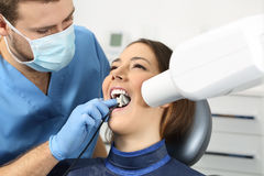 Dentist taking a teeth radiography. To a patient in an office Stock Photos