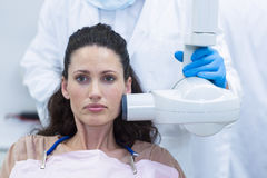 Dentist taking x-ray of patients teeth Stock Image