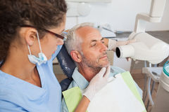 Dentist taking an xray of patients mouth Stock Photos