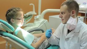 Dentist talking to patient before treatment stock footage