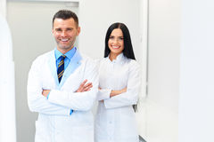 Dentist Team at Dental Clinic. Two Smiling Doctors at their Work. Place Stock Image