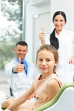 Dentist Team and Happy Young Patient at Dental Clinic Stock Photography