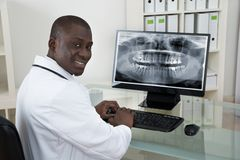 Dentist With Teeth X-ray On Computer Stock Images