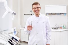 Dentist with a tool Royalty Free Stock Photos