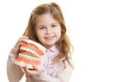 Dentist tool. Happy smiling girl with dentist tool Royalty Free Stock Images