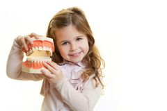 Dentist tool. Little girl with dentist tool stock photo