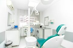 Dentist tools and dentist chair Royalty Free Stock Photography