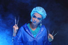 Dentist tools in hand of Fashion dentist Woman in Blue color ton royalty free stock photography