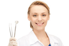 Dentist with tools Royalty Free Stock Image