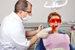 Dentist tooth filling stock photography