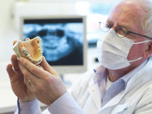 Dentist with toothache in hand Royalty Free Stock Photos