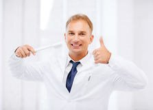Dentist with toothbrush in hospital Royalty Free Stock Images
