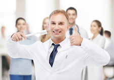 Dentist with toothbrush in hospital Stock Images