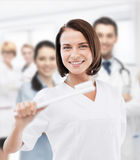 Dentist with toothbrush in hospital Stock Photos