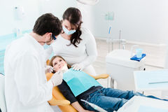 Dentist trearing child in his surgery Stock Photo
