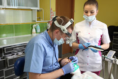 Free Dentist Treating A Patient`s Teeth With Dental Tools In Dental Clinic. Dentistry. Royalty Free Stock Image - 92943996