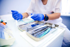 Dentist treats teeth Royalty Free Stock Images