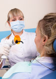 Dentist treats teeth patient Stock Photography
