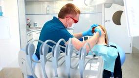 Dentist treats teeth stock video footage