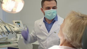 Dentist turns on the dental light stock video footage
