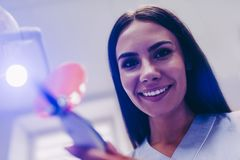 Dentist with uv lamp in the clinic royalty free stock photos