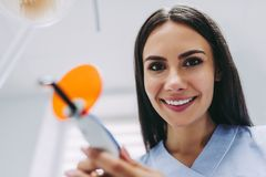 Dentist with uv lamp in the clinic royalty free stock photo