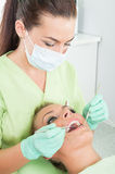 Dentist woman and female patient stock photo