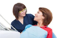 Dentist woman and patient looking at each other Stock Image