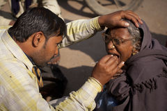 Dentist with a woman patient at the roadside in Va. Dentist with an old woman patient at the roadside in Varanasi, India. Roadside dentists are common in India Royalty Free Stock Photos