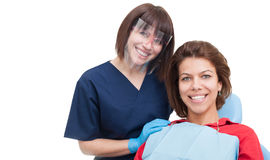 Dentist woman and patient smiling Royalty Free Stock Image