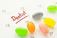 Dentist word in calendar with colorful candy. Stock Photography