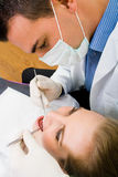 Dentist at work Stock Photography