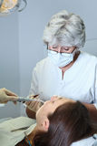 Dentist at work. In dental room Royalty Free Stock Images