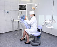 Dentist at work. In dental room Stock Photo