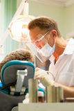 Dentist at work Stock Image