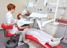 Dentist at work in dental room. Dental surgery Royalty Free Stock Image