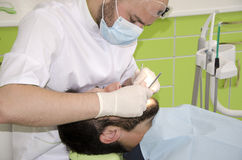 Dentist at work. Dentist and patient Royalty Free Stock Images