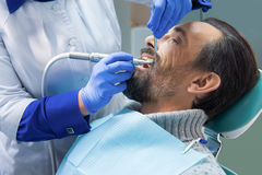 Dentist at work. Patient in dental chair Royalty Free Stock Image