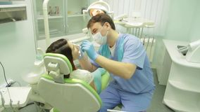 Dentist working . Girl having a check up at dentists surgery.